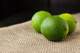 Limes on a jute table cloth