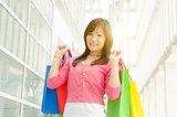 Asian girl holding shopping bags
