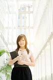 Young Asian woman executive smiling