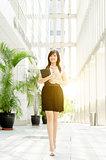 Young Asian woman executive walking