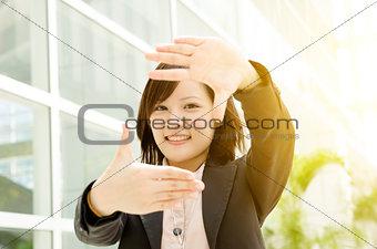Asian business woman making hand frame