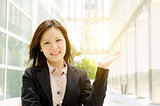 Asian business woman hand holding somethings