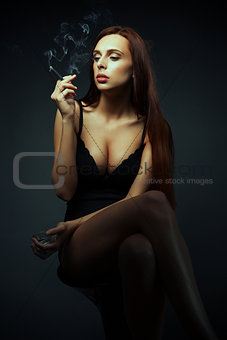 attractive sexy girl with cigarette dark scene