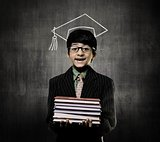 Genius Little Boy Holding Books Wearing Graduation Cap, Chalkboa
