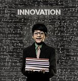 Innovation. Genius Little Boy Holding Book Wearing Glasses Chalk
