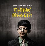 Think Bigger. Genius Little Boy Wearing Glasses, Thinking Near