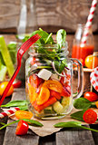 Fresh healthy vegetable salad in glass jar