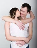 Young and passionate couple in love. Lovers. Couple in love embracing. Sexy beauty couple hugging and kissing