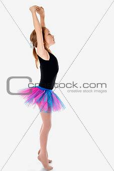 Little Ballerina in tutu on a white studio background.