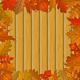Autumn leaves and wooden fence