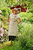 senior woman standing in garden