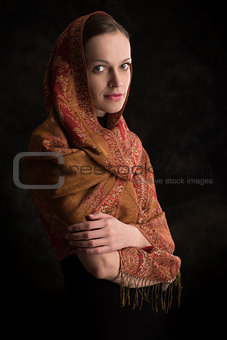 beautiful girl enveloped in headscarf