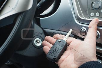 Car key on a palm