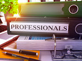 Professionals on Black Office Folder. Toned Image.