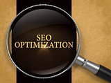 SEO Optimization through Loupe on Old Paper.