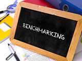 Hand Drawn Benchmarking Concept on Small Chalkboard.