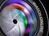 Watch Online on Front Glass of Camera Lens. Closeup.