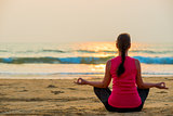 relaxation in the lotus position by the ocean