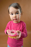 Little girl with  donut
