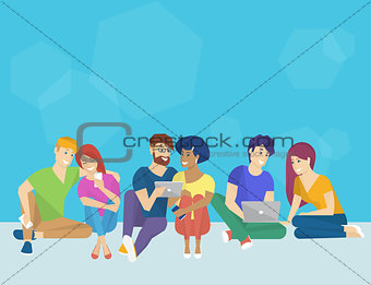 Group of creative people using smartphone, laptop and tablet pc sitting on the floor