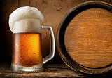 Frothy beer and barrel
