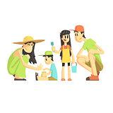 Family Of Four In Sandbox