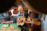 Boy Learns Play Guitar With Senior Man Grandpa