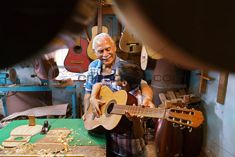 Boy Learns Play Guitar With Senior Man Grandpa