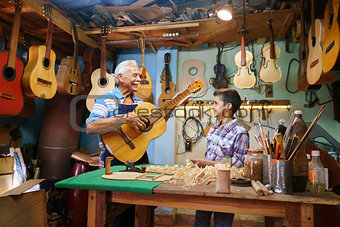 Old Man Grandpa Teaching Boy Grandchild Playing Guitar