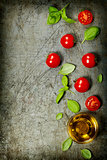 Cherry tomatoes with basil leaves and olive oil