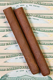 US dollar banknotes and Cuban cigars