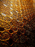 Textured cloth from patterns of gold color.