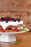 Mulberry and red currant cake with whipped cream