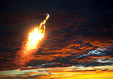 Carrier Rocket Takes Off On A Background Of Red Clouds