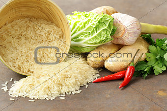 Asian food - rice, ginger, chili pepper on a stone background