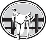 Old Style Western Saddle on Fence Oval Black and White