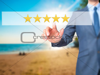 Five star rating - Businessman hand pressing button on touch scr