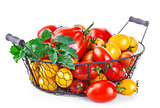 Basket red and yellow tomatoes with green leaf