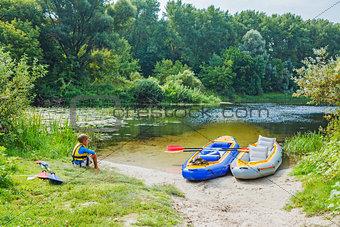 Boy kayaking on the river