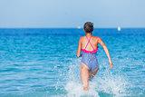 Girl running through the water