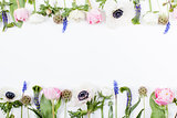 Spring flowers, tulips, anemones, cloves and buttercups in two r
