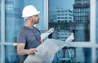 Architect builder studying layout plan of the rooms