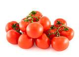 Pile of red tomato bunches over white background