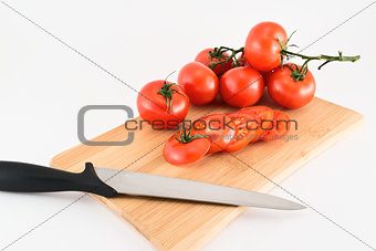 Cutting red tomatoes composition background