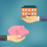 Hand with piggybank and hand with house.