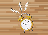 yellow clock deadline with wood background