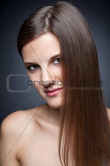 Beautiful brunette with long straight hair