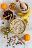 Rolled oats, honey and other ingredients for a healthy breakfast