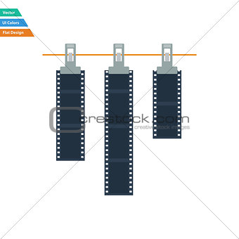 Flat design icon of photo film drying on rope with clothespin