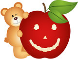 Teddy bear with smiling apple